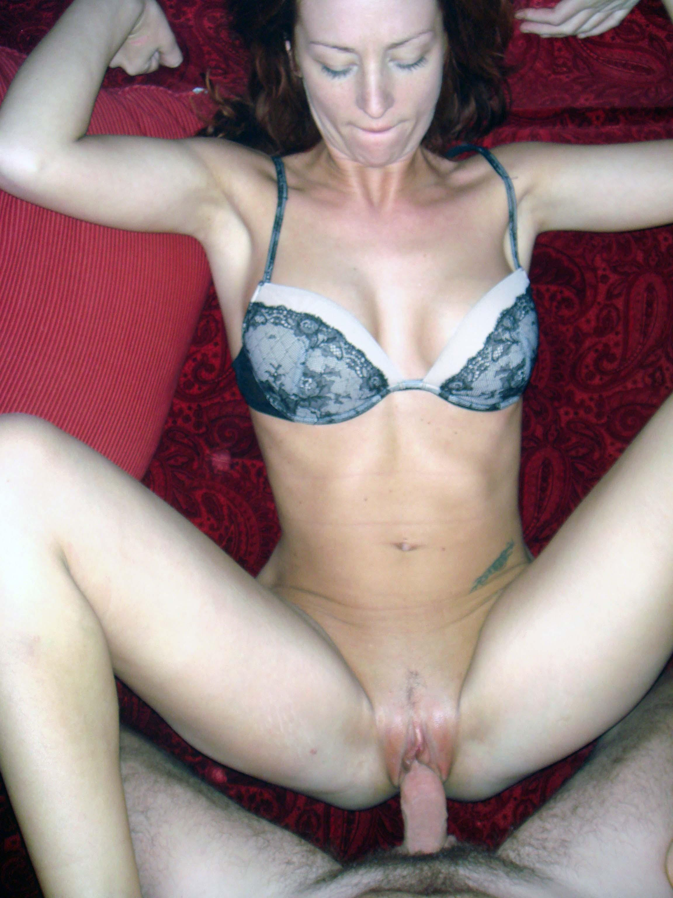 Redhead stretched on the bed fingering soft
