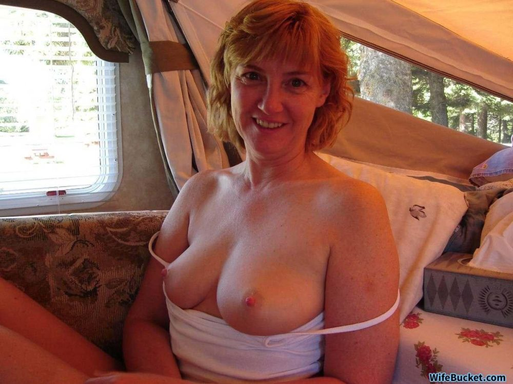 Mature wife nude in the car