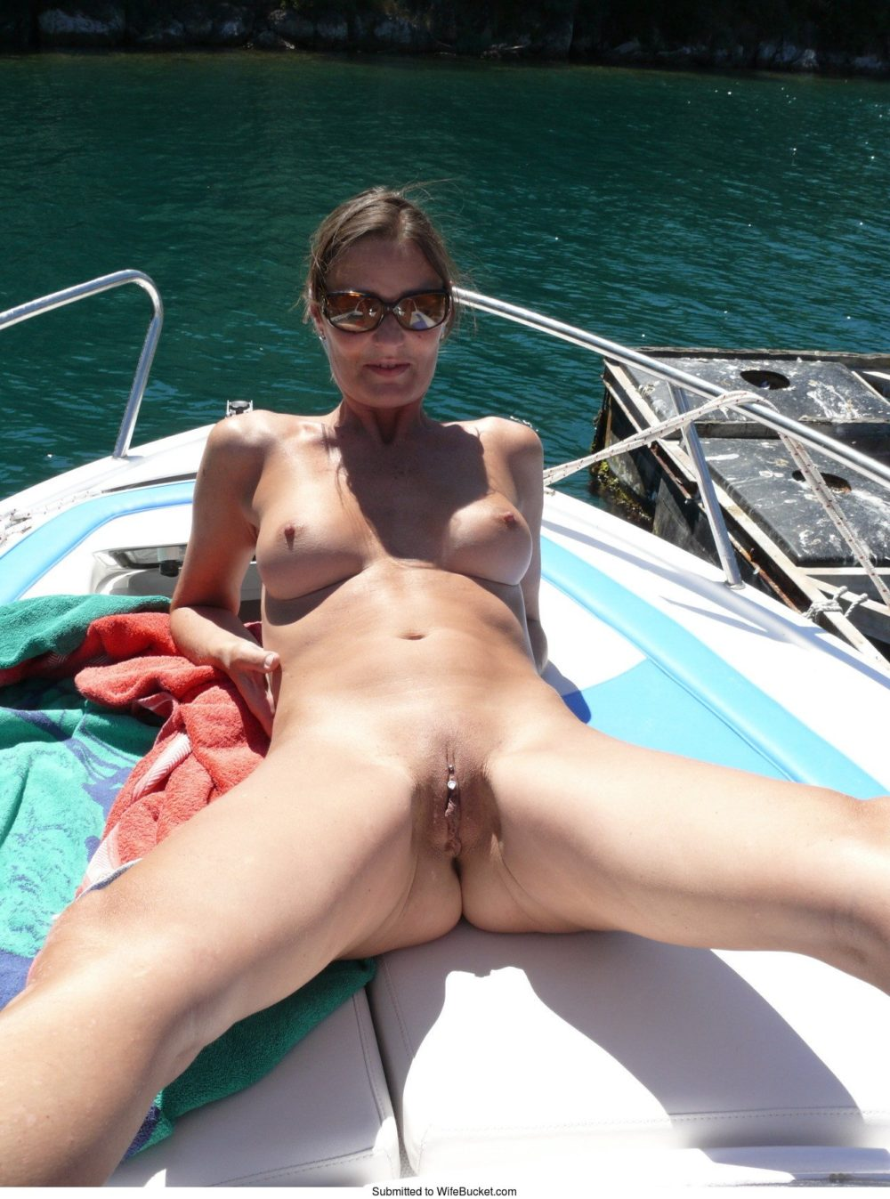 nude spread on boat