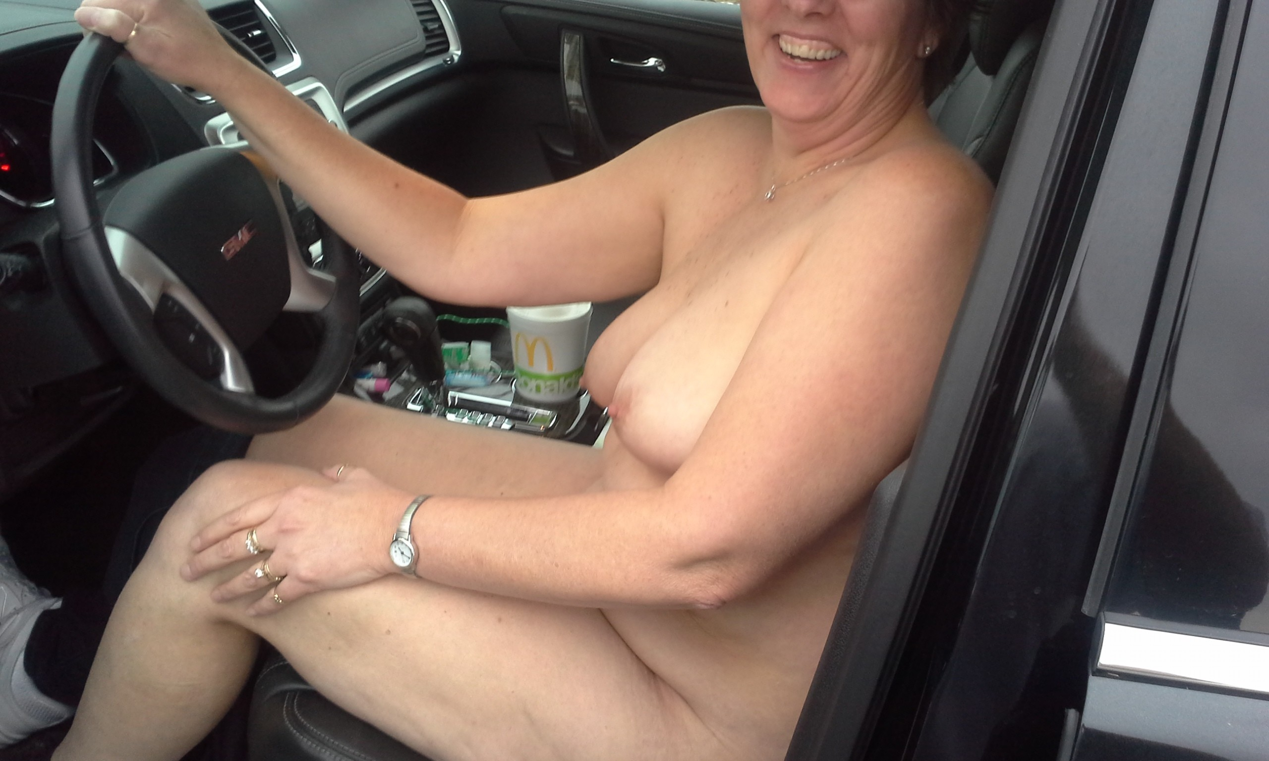 Milf shows pussy while driving this