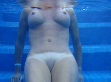 Older MILF nude in the pool