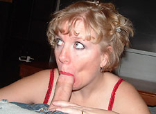 Curly-haired MILF sucks a meat stick