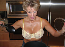 MILF cooking in a bra