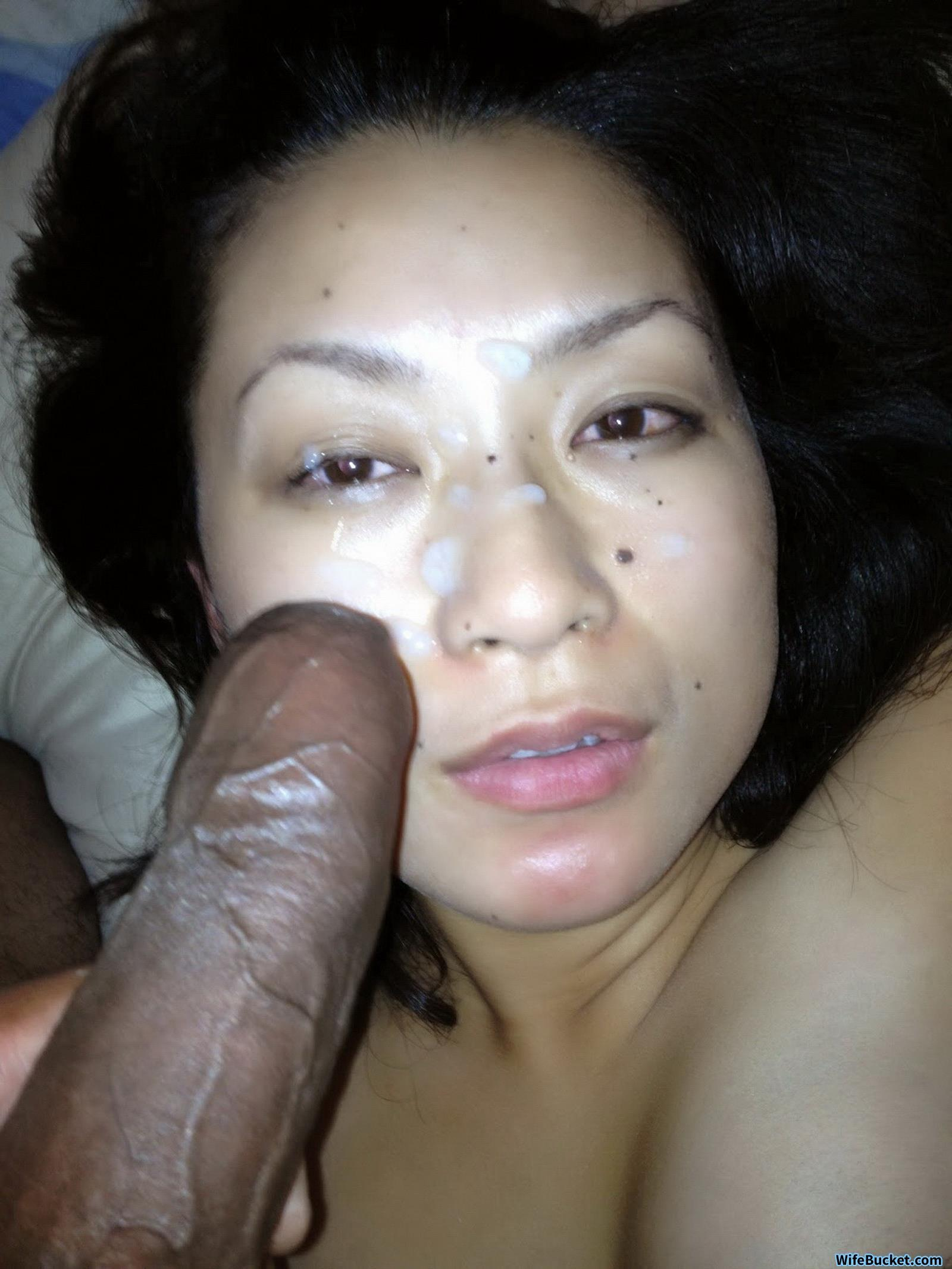 Asian whore receives a creamy facial 10