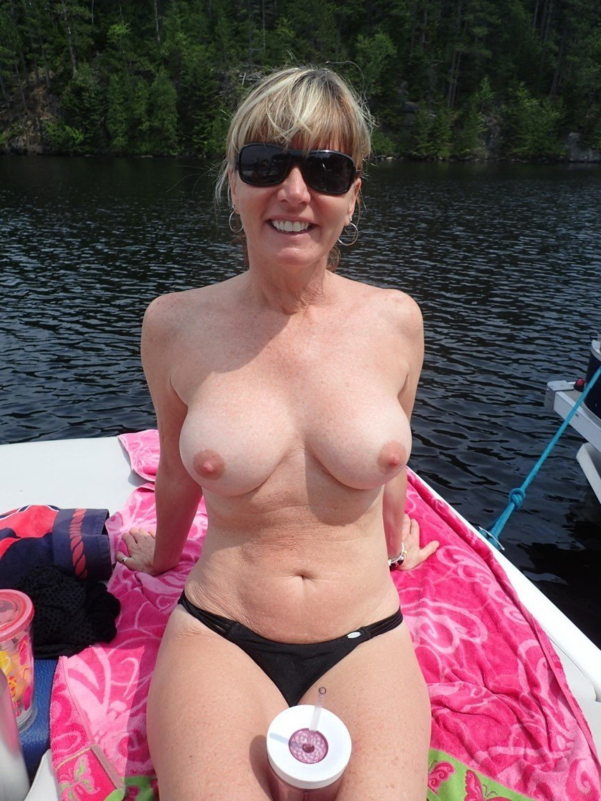 amateur cougar naked on a boat